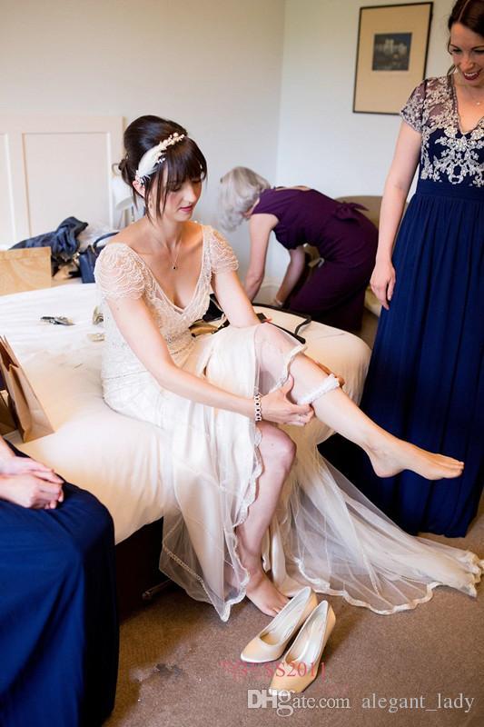 빈티지 gastby 제니 Packham의 웨딩 드레스는 다시 Boho 웨딩 착용을위한 빈티지 비치 신부 드레스 엿보기 깊은 V 넥 짧은 소매