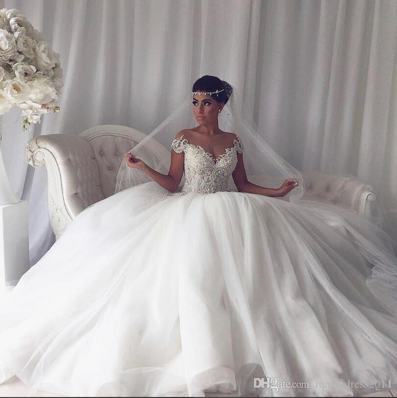Luxury Arabic Lace Ball Gown Wedding Dresses 2019 Sheer Neck Beaded Cap Sleeves Tulle Gowns Vintage Sexy Bridal Gowns