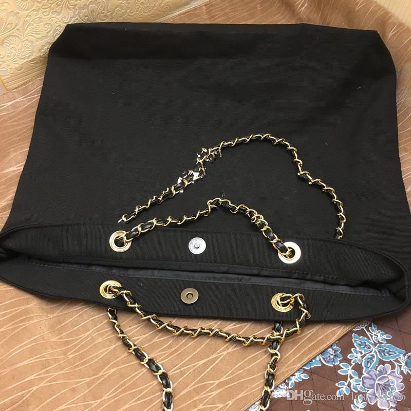2017 NOUVEAU ~ cadeau VIP shopping Canvas Bag avec motif de luxe de la chaîne Travel Bag Women Wash Bag. Sac de plage en toile