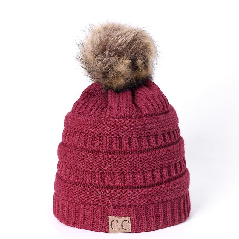 383a00ff109 High Quality Letter CC Beanies Cotton Add Wool Fur Ball Cap Pom Poms ...