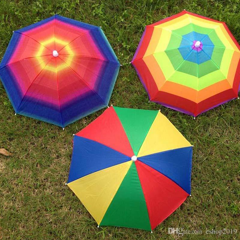8a2ab65a79405 2019 2017 New Umbrellas Rainbow Umbrella Hat Portable Umbrellas Hat Folding  Elastic Strap Fishing Umbrella Cap From Eshop2019