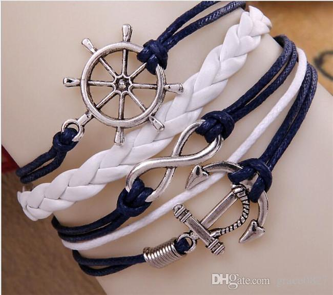 Nuevo en 9 diseños Pulsera de cuero Antique Cross Anchor Love Melocotón corazón búho Bird Believe Pearl Knitting pulsera del encanto de bronce Envío gratis