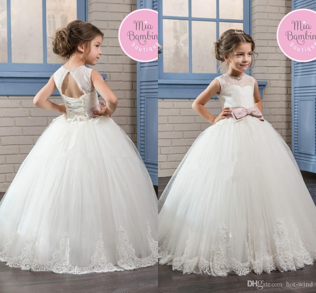 2020 New Princess White Sleeveless Flower Girl Dresses Crew Sheer Neck Open Back Corset Tulle Lace Appliqued First Communion Gowns Custom