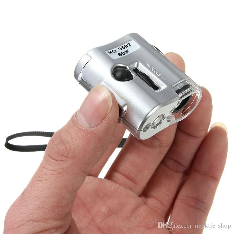 Mini microscopio 60X Magnifier illuminato Magnifier Glass Jeweler Lente con strumento di riparazione di orologi a luce UV a LED