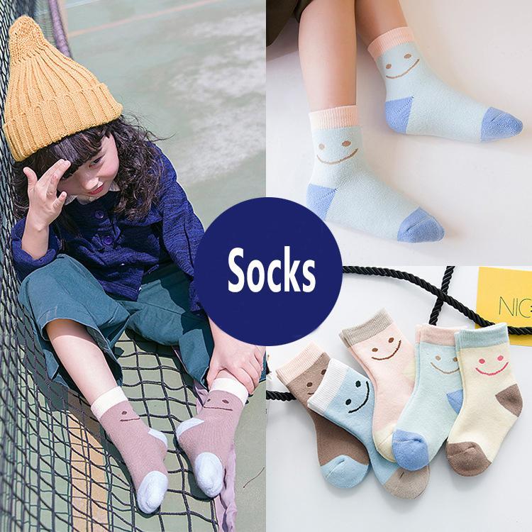 New Winter Thickening Knee high Socks Kids Children Socks Candy color Cartoon Lovely Smile Printed Cotton Warmer Socks Wholesale