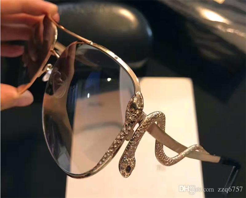 Compre Novas Mulheres Da Moda Designer De Óculos De Sol De Metal Animal  Piloto Quadro Cobra Em Forma De Pernas Com Diamantes Proteção De Alta  Qualidade ... 0af67a04aa