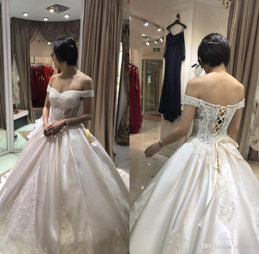 Discount Sexy 2018 Bling Ball Gown Wedding Dresses With Off Shoulder  Neckline Chapel Train Glitter Glued Lace Lace Up Real Image Bridal Gowns  Ball Gown ... d75be561c5d9