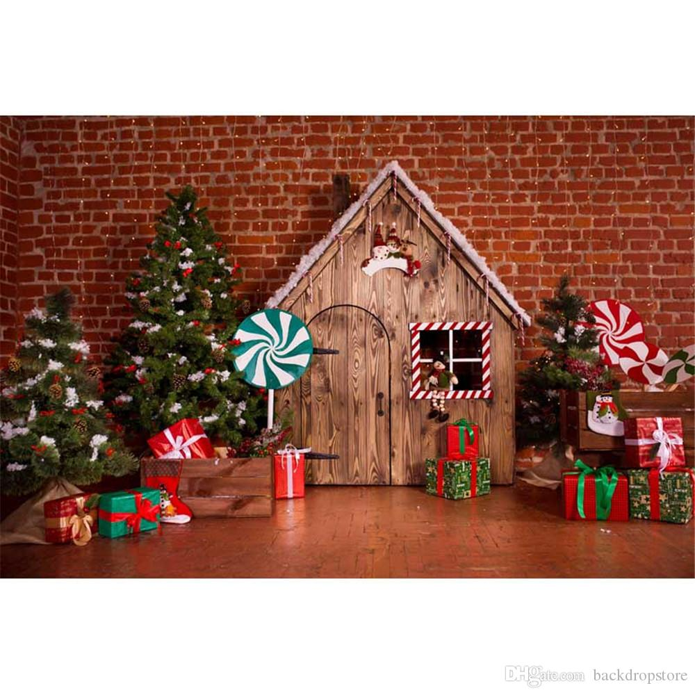 interior brick wall wood house christmas tree backdrop photography green red lollipops gift boxes children kids new year photo background christmas tree