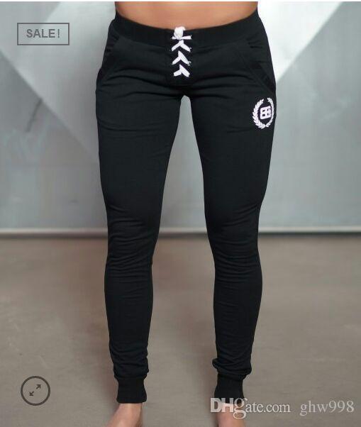 Pantalones elásticos de estiramiento al aire libre de secado rápido ajustados pantalones de fitness profesional de running pantalones casuales