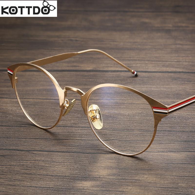 6cd595aeeb Compre Al Por Mayor Kottdo Marco Óptico De Metal Marca Gafas Mujeres  Hombres Gafas Vintage Marcos De Moda Gafas Oro Mujer De Alta Calidad A  $19.96 Del ...