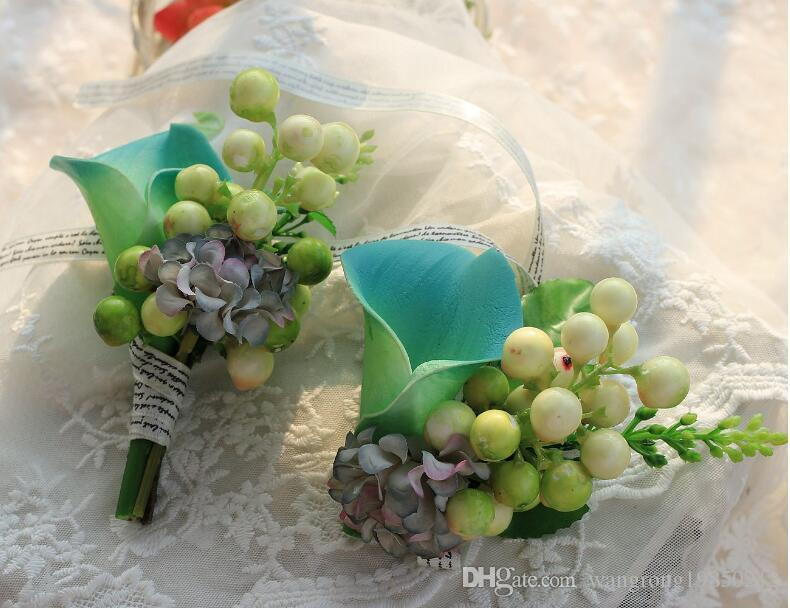 The bride bridesmaid wrist flowers The groom's best man married a corsage Callas berries corsage