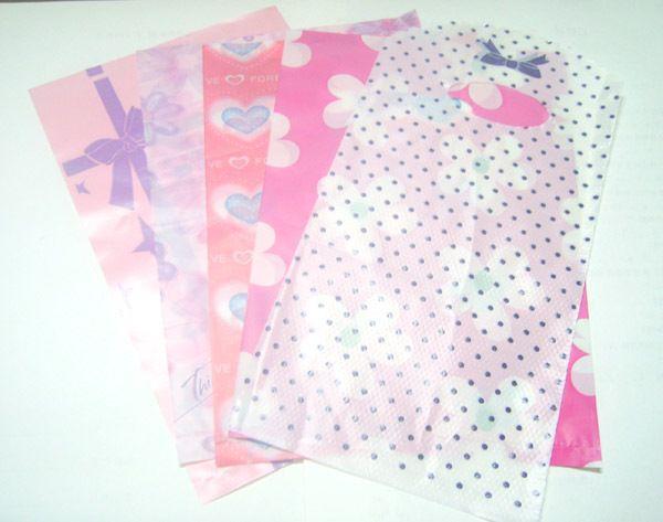 95 unids / lote mezcla de colores diseño plástico compras bolsas de regalo bolsas para compras regalo de joyería WB15 envío gratis