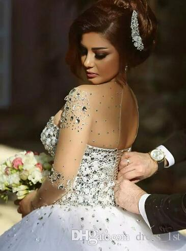 Luxury 2016 Hot Sale Crystal Beaded Illusion Long Sleeve Wedding Dresses Sexy Sheer Neck Lace Up Back Tulle Bridal Gowns Cutom EN3293