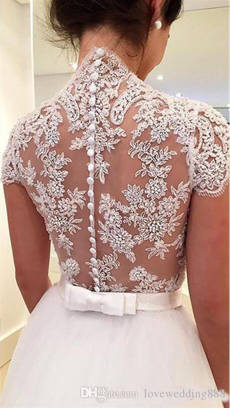 2018 Arab Cheap A Line Wedding Gowns Applique Tulle Cap Sleeve Covered Button Back Illusion Bridal Dress Vintage