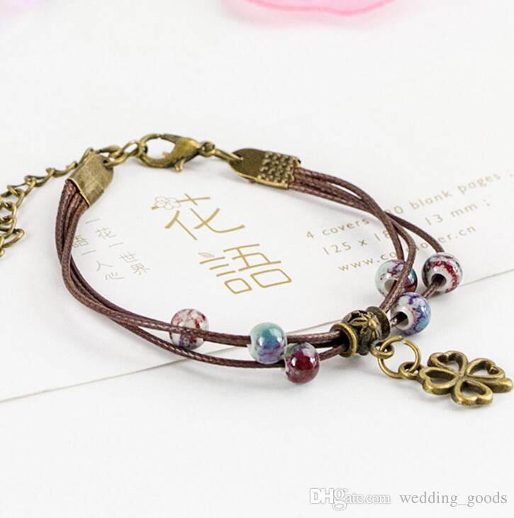 Gute A ++ Gui Honig Keramik Armband Kunst kleine frische süße Mode weibliche Hand String FB514 Mix Auftrag 20 Stück viel Slap Snap Bracelets