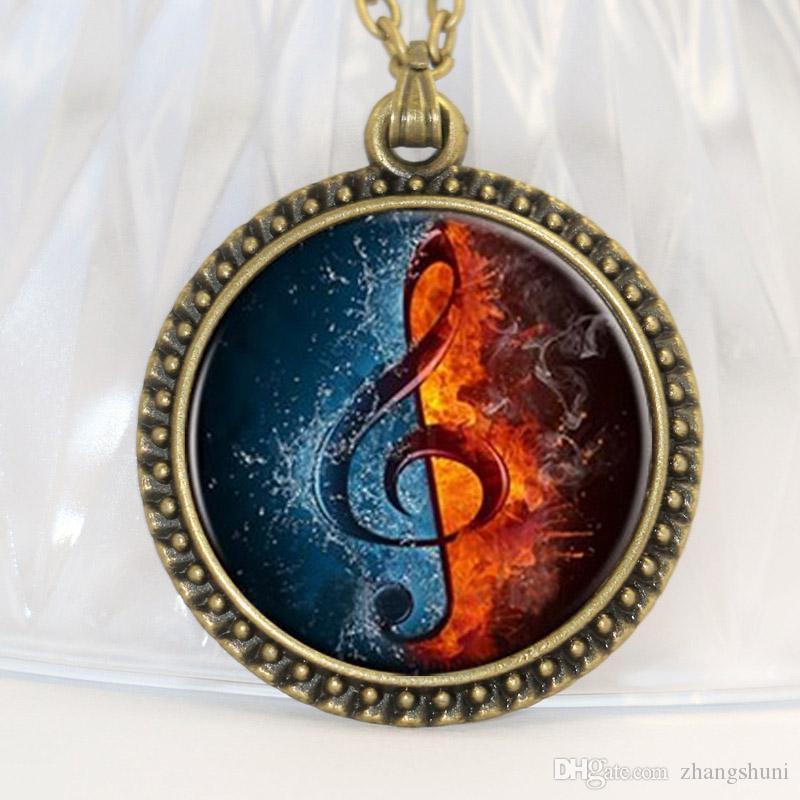 Livraison gratuite mode notes de musique collier de musique est une demi-eau et un demi feu en alliage de zinc pendentif en verre rétro collier
