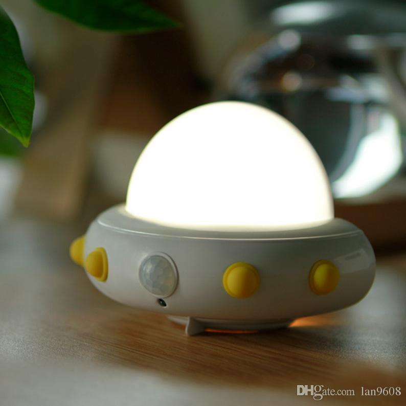 Flying saucer night light intelligent human body sensor built-in lithium battery charging bedroom bed baby room four-color choice