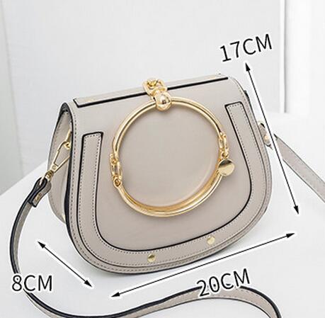 Verano Nuevo bolso de cuero genuino Paquete de anillo de metal Saddle Metal Nile Mango Bolsa Bolsa de pulsera Hombro Mensajero Crossbody Bolsas
