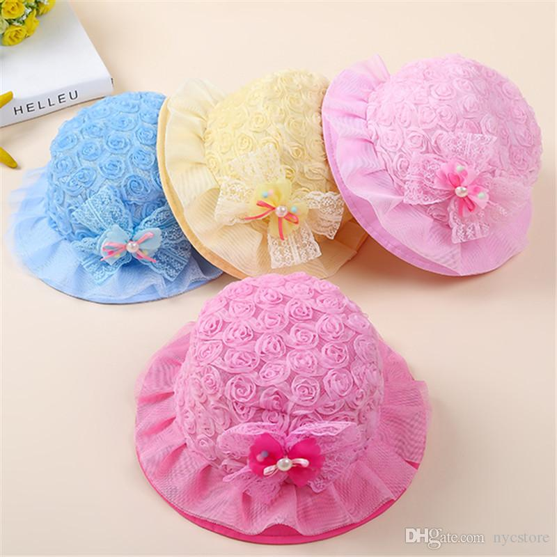638be34bcaa02 2019 Baby Rose Flower Caps Babies Hat Kids Bow Fedora Hat Girls Sun  Protection Children Summer Hat Jazz Cap Pearls From Nycstore