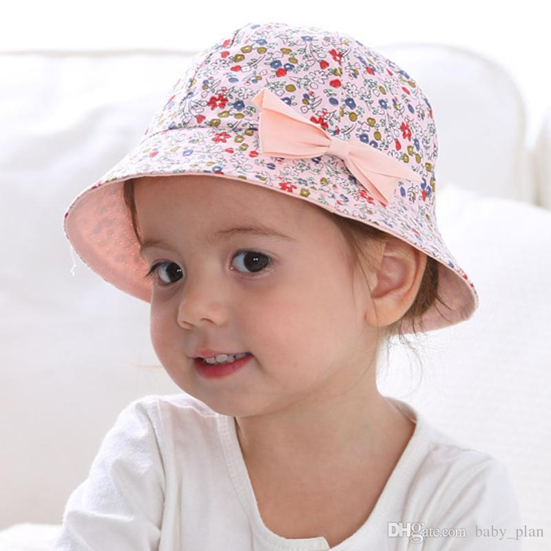 94c85000ee 2019 New Flower Print Cotton Baby Summer Hat Kids Girls Floral Bowknot Cap  Sun Bucket Hats Double Sided Can Wear Gorro From Baby_plan, $2.33 |  DHgate.Com