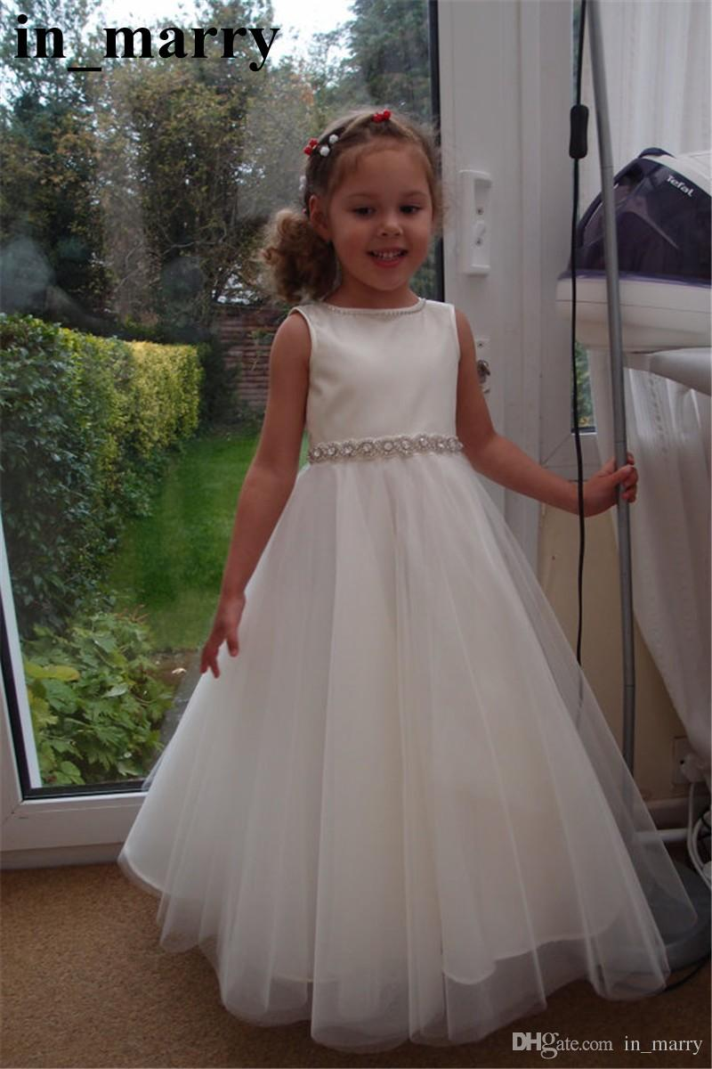 Sparkly crystals beaded white girls first communion dresses 2017 a sparkly crystals beaded white girls first communion dresses 2017 a line jewel belts long tulle cheap simple princess flower girls dresses girls white shoes izmirmasajfo