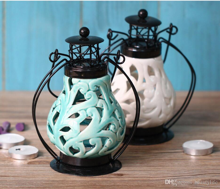 Cinese vento hollow candeliere di ceramica piuma di ferro candelabro candela di nozze marocchine lanterne di natale ornamento di nozze decorazioni la casa