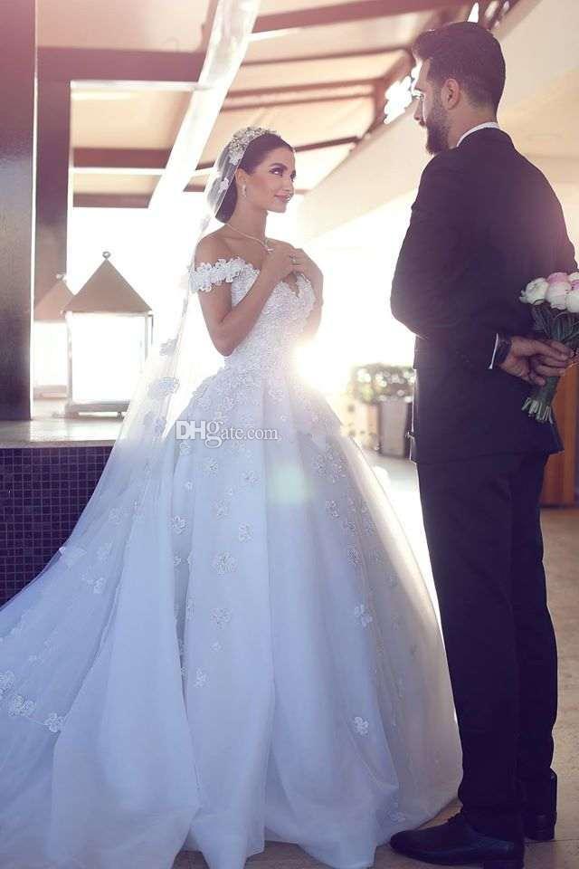 Newest Ball Gown Weddding Dresses Off Shoulder Floral Appliques Tulle Organza Backless Chapel Arabic Bridal Wedding Gowns Dubai