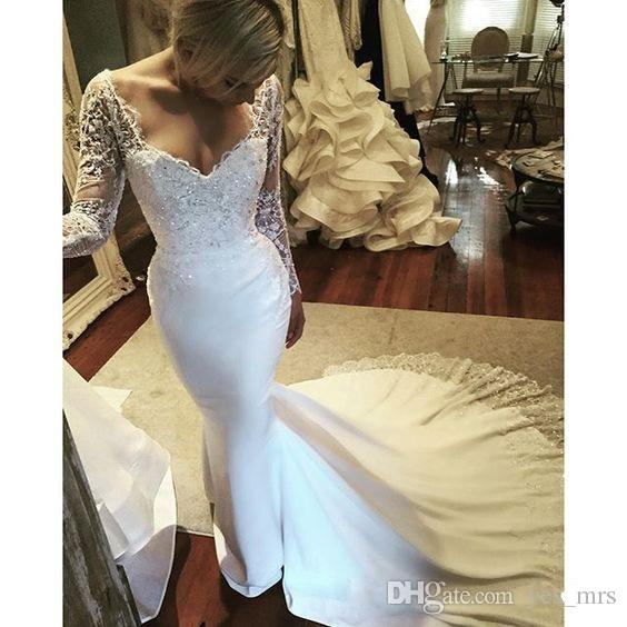 2017 New African Mermaid Wedding Dresses Sweetheart Sheer Long Sleeves Lace Appliques Crystal Beaded Sweep Train Satin Formal Bridal Gowns