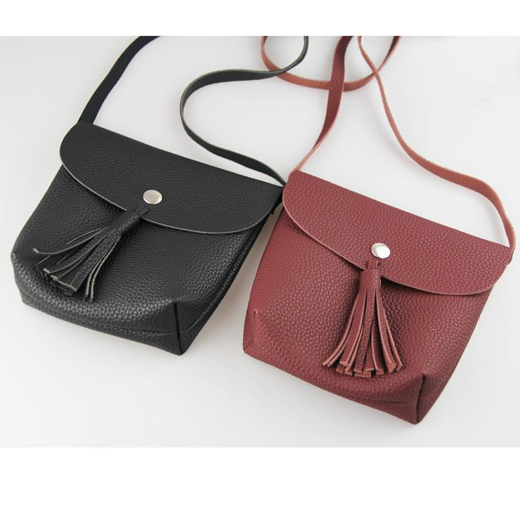 a928b5f39251 Wholesale 2016 New Designer Fashion Tassel Women Bag Mini Bags Women  Shoulder Bags Cute Phone Bag Leather Tote Handbags Relic Purses From Murie