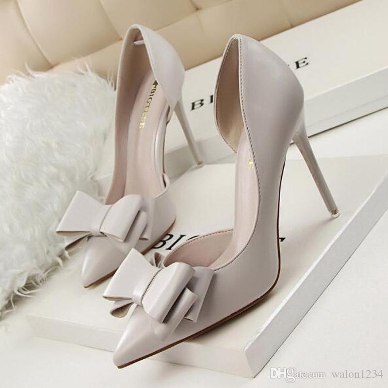 Nuevas bombas de mujer Zapatos de tacón alto de Bowknot dulce Zapatos rosados de tacón alto Estilete de punta hueca elegante