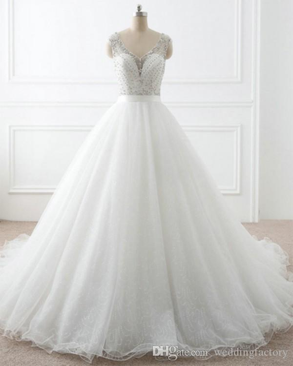 Sparkly bröllopsklänningar en linje ren v nacke ärmlös beading topp illusion tillbaka sequined tulle bling bling brud klänningar
