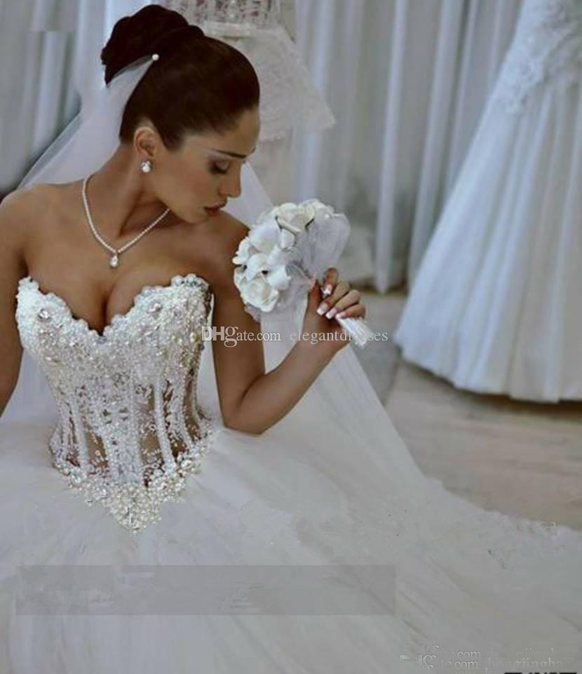 White 2021 Spring New Wedding Dresses Sweetheart Lace Up Illusion Bodice Crystal Floor Length Sleeveless Applique Gowns Plus Size