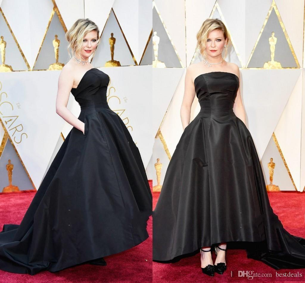 b4e2816e17 Kirsten Dunst 89th Oscars 2017 Celebrity Evening Dresses Black Ball Gown  Strapless Hi Lo Ruffled Formal Prom Dress Party Gowns Holiday Evening  Dresses Ivory ...