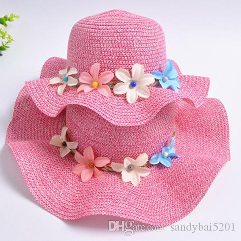 2019 Mother Daughter Hat Mom Girl Flowers Decorated Straw Hats Women Wide  Large Brim Floppy Caps Kids Girls Hats Family Beach Sun Hat B390 From  Sandybai5201 ... a2328de2af7c