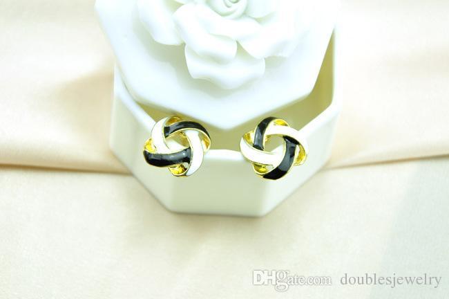 Européens et américains de la mode simple style all-match féminin creux tressé noir et blanc croix huile main bijoux fabricants en gros se