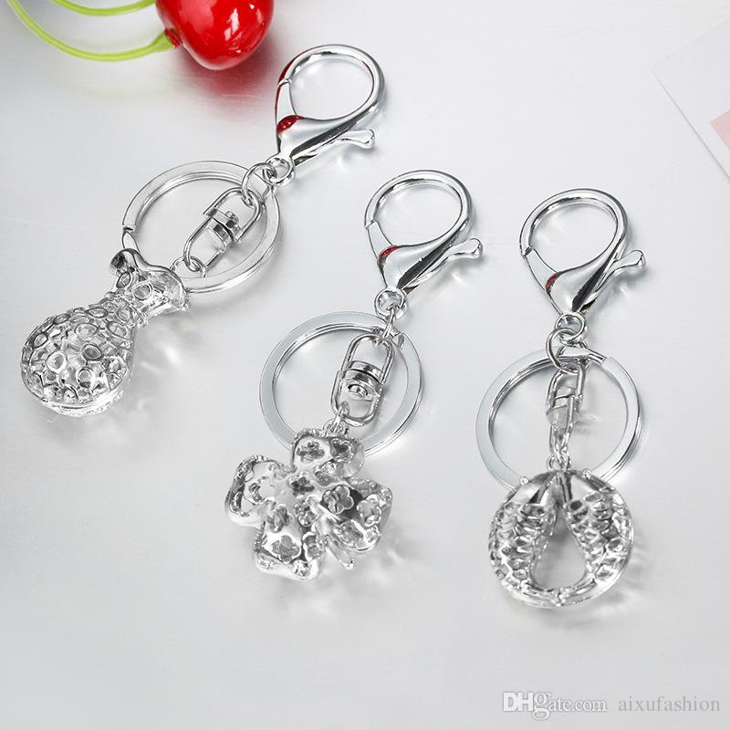 2017 New Heart Bell Key Chain Color Silver Color Fish Apple Llavero Moda Aleación Símbolo Anillos Llave de moda Hebilla