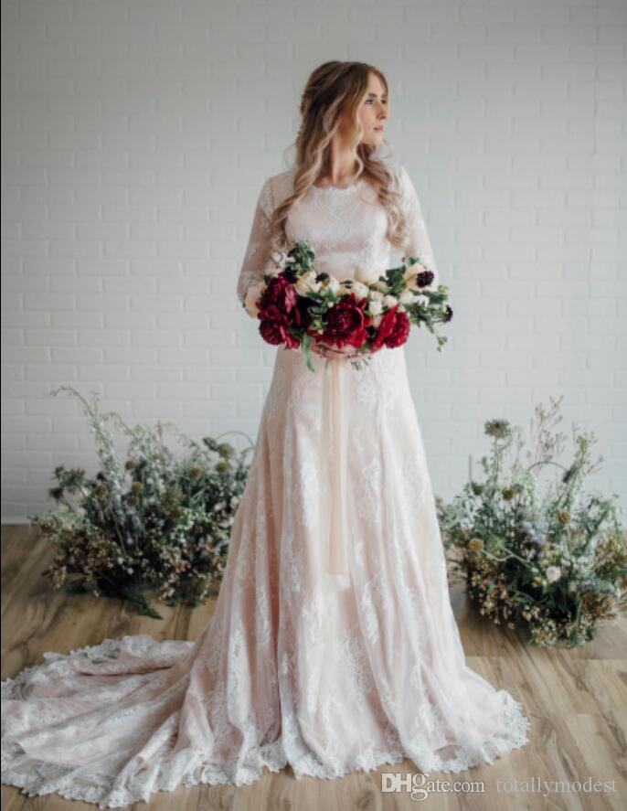 Abiti da sposa modesti in pizzo a sirena rosa con maniche lunghe gioiello collo abiti da sposa bohemien stile country su misura