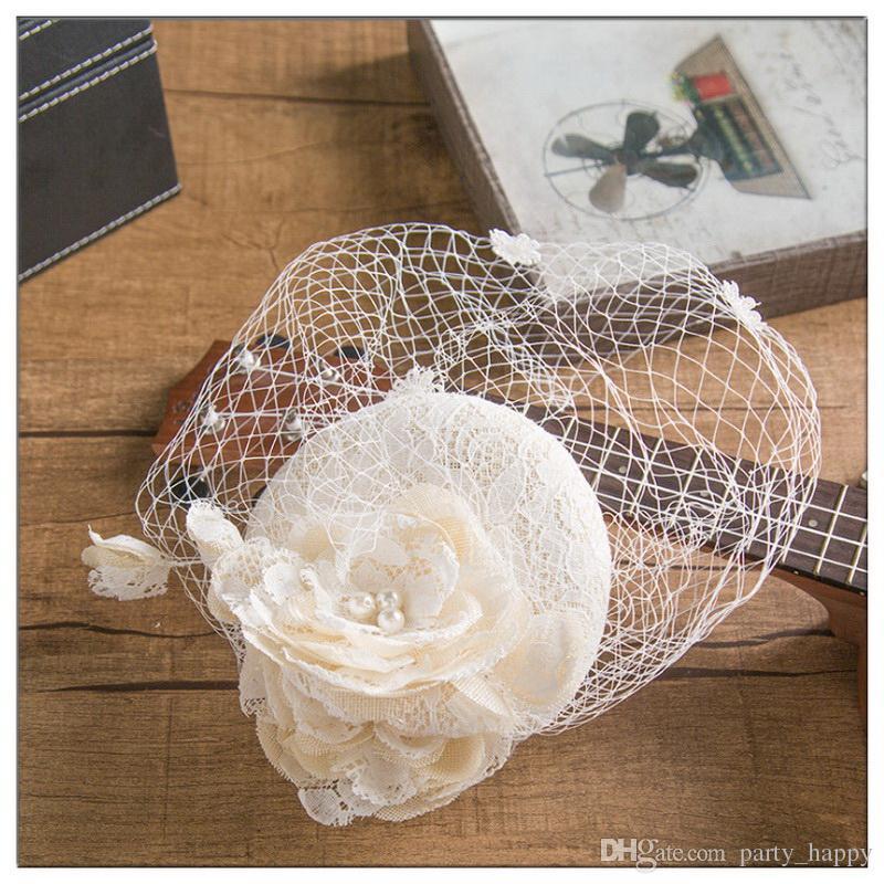 Hermosa Vintage Francia Birdcage Flor nupcial Flores hechas a mano Fascinator Novia Boda Sombreros Velos en la cara Moda de mujer