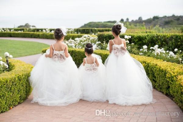 Princess Long Flower Girl Dresses Spaghetti Straps Puffy Tulle Girls Pageant Gowns with Train and Bow Crystals