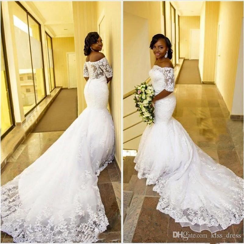Vestidos de novia de sirena africana árabe Tallas grandes Tren de corte Ver a través de la espalda Fuera del hombro Vestidos de novia de encaje de media manga 2019 Nuevo W650