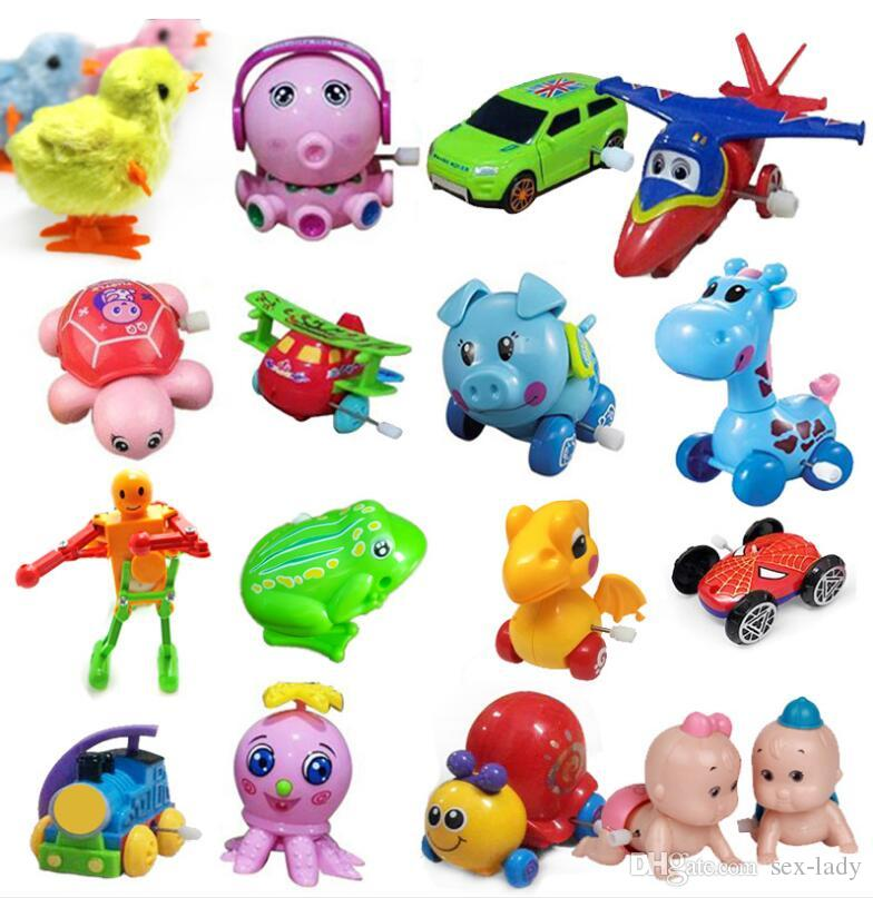 Kids Classic Clockwork Toys Wind-up toy Cartoon Animal Frog Giraffe Dinosaur pig Car Fish the best Gift for baby Kids Mix Design