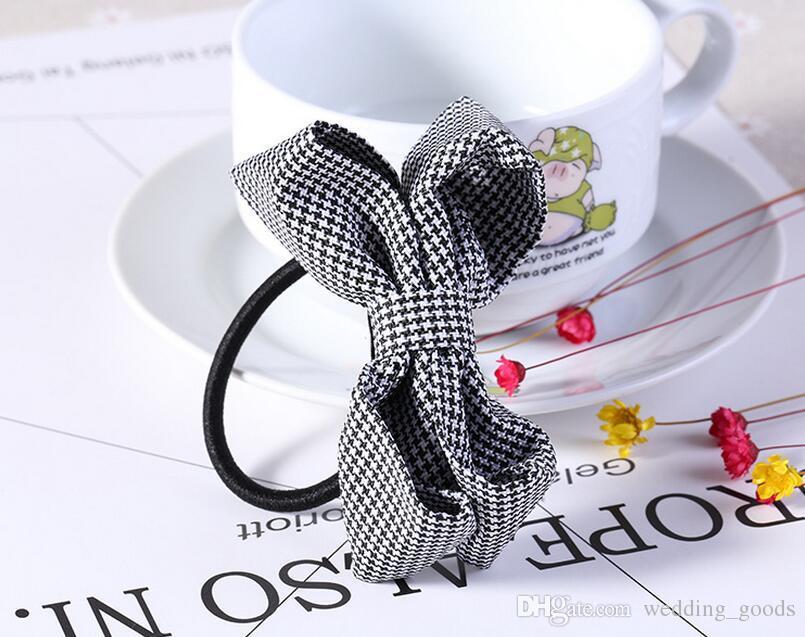 A estrenar Bowknot romántico nudo cabeza banda de goma cuerda de pelo FQ009 orden de la mezcla 100 unidades mucho