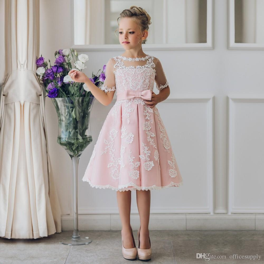 Fancy Blush Pink Comunione Flower Girl Dress con appliques Mezze maniche al ginocchio Lunghezza Girls Pageant Gown con fiocchi al fiocco il Natale