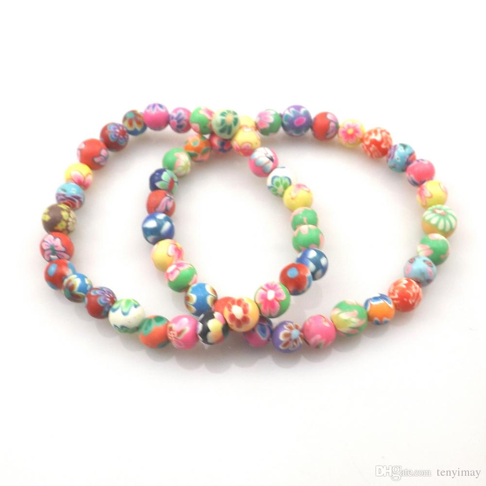 Los niños imprimieron la pulsera moldeada 6m m las pulseras de la arcilla del polímero para los niños de la escuela / venden al por mayor el envío libre