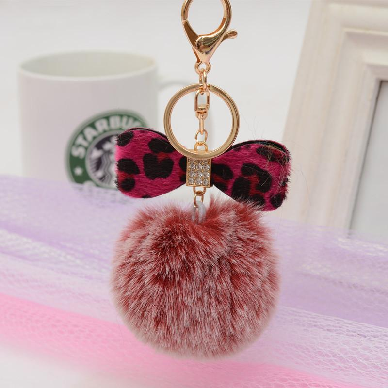 New Fashion leopard Leather bowknot Rabbit Fur Keychain Ball Pompom Cell Phone Car Handbag Metal Charm Car Jewelry Bag Pendant