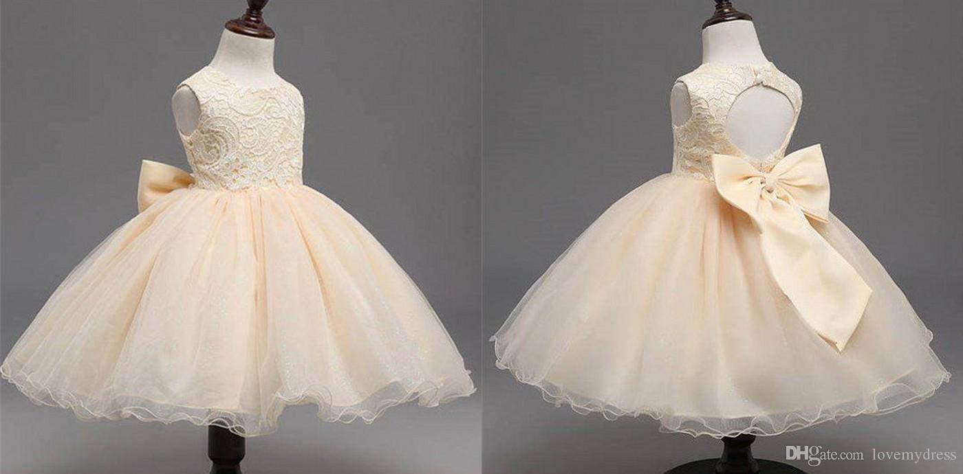 dc00694d7b166 2019 Champagne Lace Flower Girls Dresses For Wedding Ball Gown Knee Length  Big Bows Keyhole Back Organza Designer Graduation Dresses For Kid