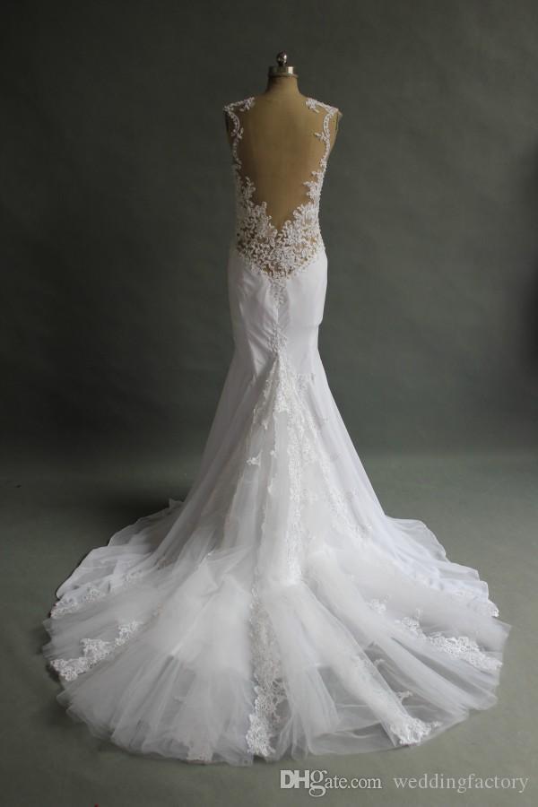 Bedövning sjöjungfrubröllopsklänning Sheer Tulle Back Pearls Lace Appliques Jewel Neck Sweetheart monterade brudklänningar med Tulle Train