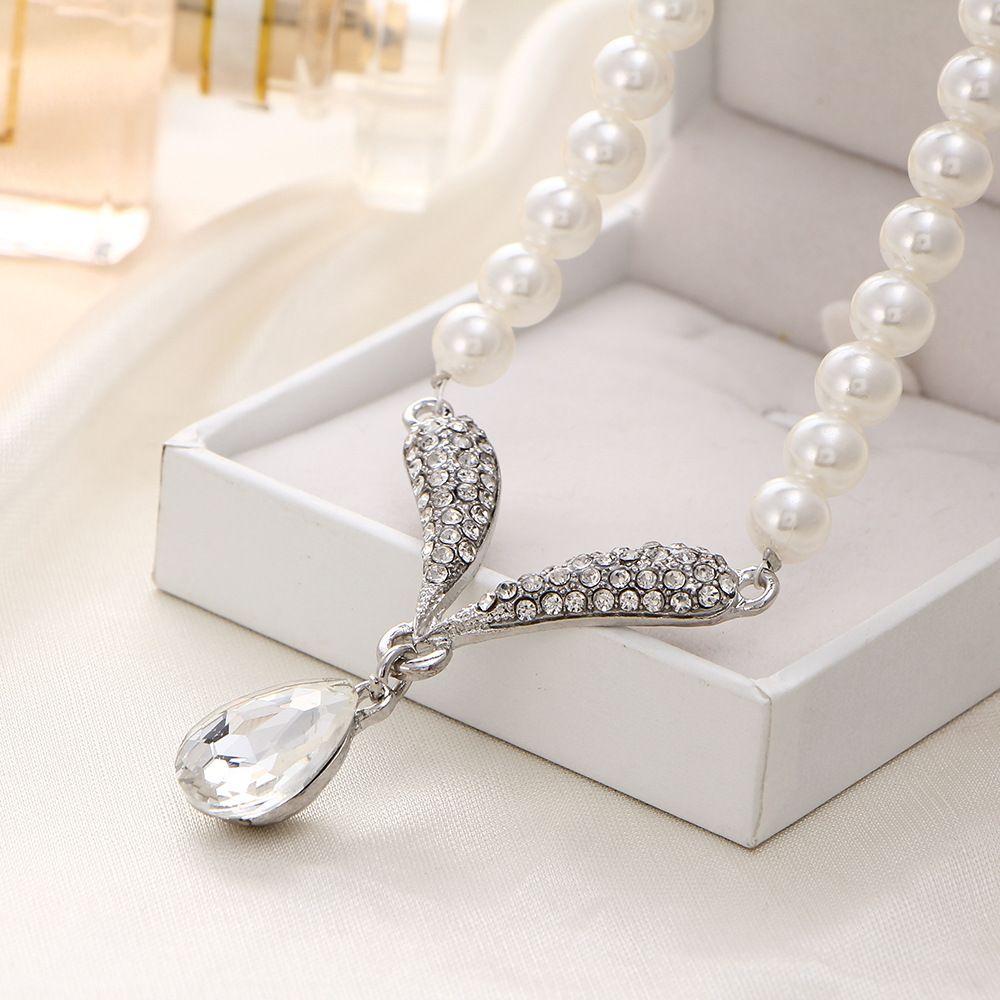 유럽과 미국의 신부 크리스탈 다이아몬드 진주 목걸이 펜던트 쥬얼리 목걸이 귀걸이 두 세트의 첫 번째 쥬얼리