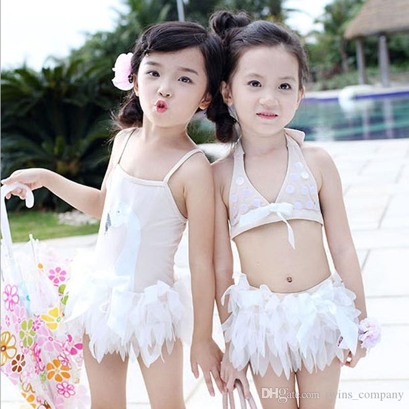 786e62e18e599 2019 Children Baby Girls Swimsuit Soft Comfortable White Swan Pattern Girls  Swimming Skirt Beach One Piece Kids Swimwear With Cap From Twins_company,  ...