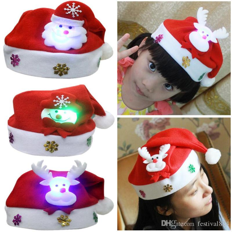 8af7dd50b4f6b New Christmas LED Hats For Children  Adults Cartoon Santa Claus Snowman Elk Xmas  Cap Christmas Party Cosplay Supplies Gift